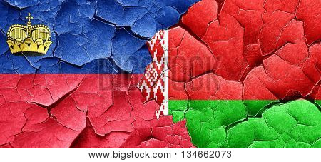 Liechtenstein flag with Belarus flag on a grunge cracked wall