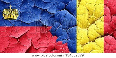 Liechtenstein flag with Romania flag on a grunge cracked wall