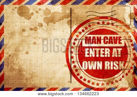 man cave sign, red grunge stamp on an airmail background