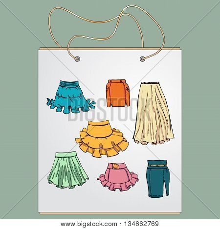 Shopping bag, gift bag with the image of fashionable things.Fashion set. Various skirts. Illustration in hand drawing style.