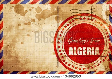 Greetings from algeria, red grunge stamp on an airmail backgroun