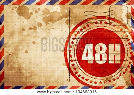 48 hours, red grunge stamp on an airmail background
