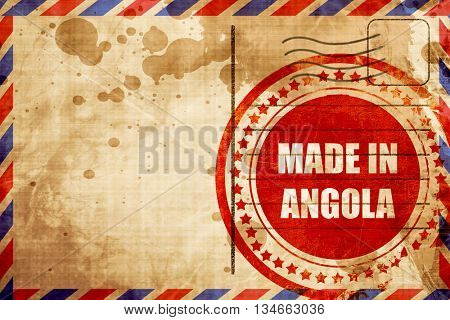 Made in angola, red grunge stamp on an airmail background