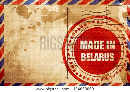 Made in belarus, red grunge stamp on an airmail background