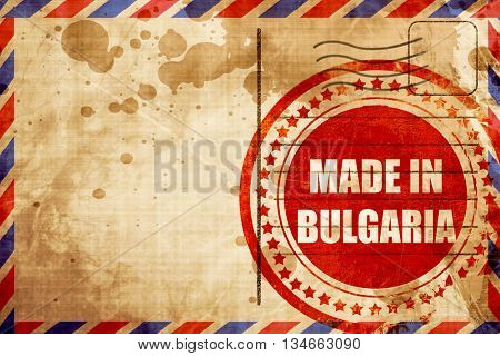 Made in bulgaria, red grunge stamp on an airmail background