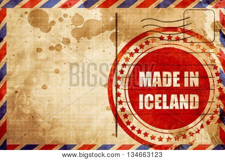 Made in iceland, red grunge stamp on an airmail background