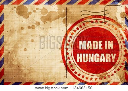 Made in hungary, red grunge stamp on an airmail background