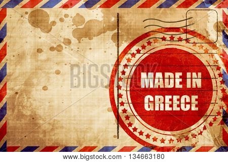 Made in greece, red grunge stamp on an airmail background