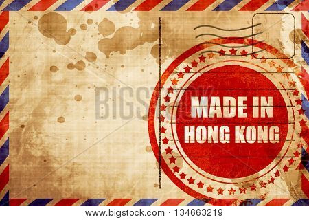 Made in hong kong, red grunge stamp on an airmail background