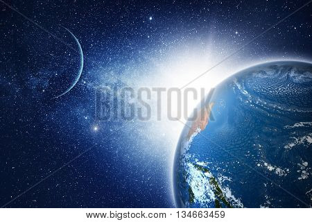 Earth planet with sunrise in space. Elements Of This Image Furnished By Nasa.