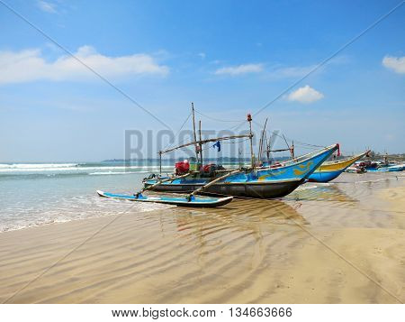 Sri Lankan fishing boats at the beach in Weligama, Sri Lanka