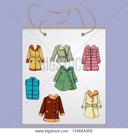 Shopping bag, gift bag with the image of fashionable things.Fashion set. Various jackets and overcoats. Illustration in hand drawing style.