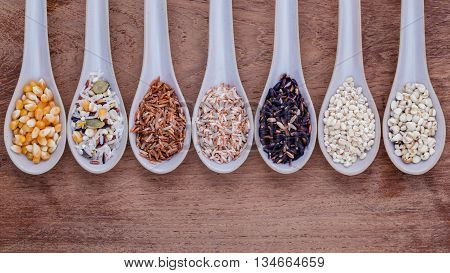 Assortment Of Traditional Thai Rice In Spoon On Wooden Background. The Supper Food High Fiber And Vi