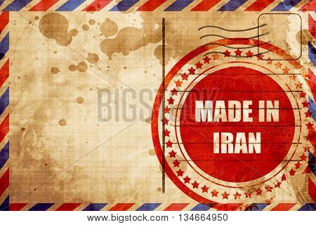 Made in iran, red grunge stamp on an airmail background