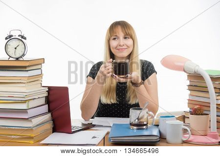 Student Enjoys A Glass Of Coffee At Night Preparing For Exams
