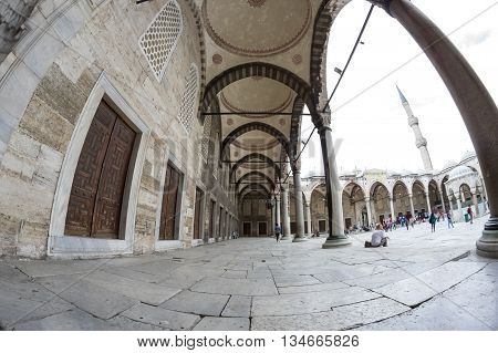 ISTANBUL TURKEY - JUNE 19 2015: People visiting Sultan Ahmet Mosque in Istanbul Turkey. The mosque is popularly known as the Blue Mosque for the blue tiles adorning the walls of its interior