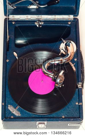 Gramophone with a vinyl record. top view