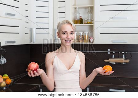 natural organic raw fresh food concept .Portrait of beautiful girl holding apples and orange fruit