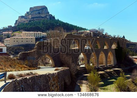 View to the aqueduct and the Morella castle. Morella is in the heart of the historic region of Meastrazgo and it is listed as one of the most beautiful towns in Spain