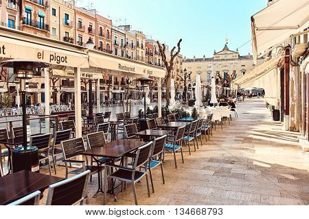 Tarragona Spain- March 23 2016: Town square in the old town center of Tarragona. It is popular touristic place with a plenty of restaurants and bars