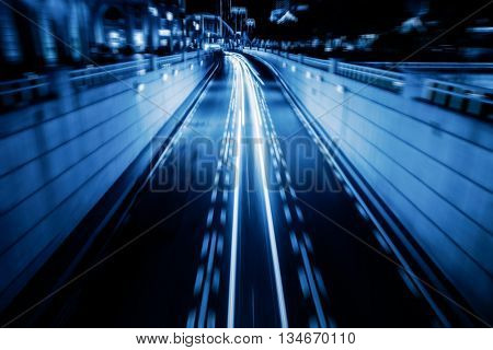 light trails with skysrapers background,tianjin china.