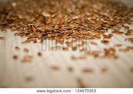 flax seed linseed on a wooden surface