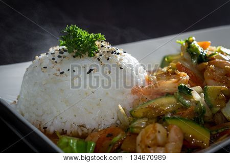 Shrimp And Vegetables Served With Stemmed Rice