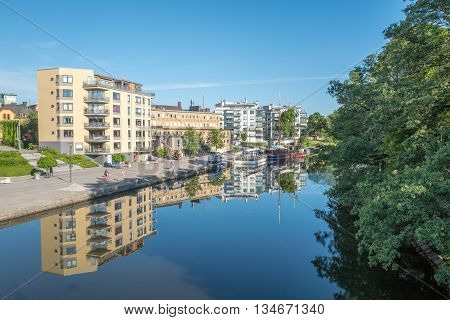 LINKOPING, SWEDEN - JUNE 3, 2016: Summer morning by river Stangan in Linkoping. Linkoping is a famous University town in Sweden.