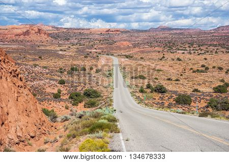 Highway Running Through Dry And Arid Scenery Of Glen Canyon National Recreation  Area