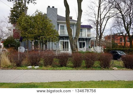 HARBOR SPRINGS, MICHIGAN / UNITED STATES - DECEMBER 24, 2015: A large home on Main Street in downtown Harbor Springs.