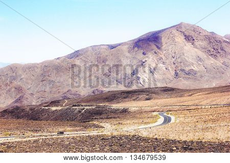 road in the middle of the desert at Death Valley national park, USA