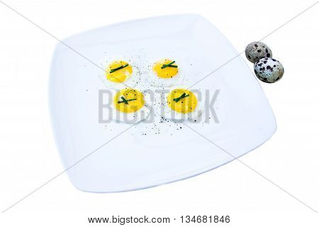 Fried quail eggs on a white background