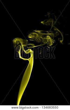 Abstract Yellow Smoke On Black Background