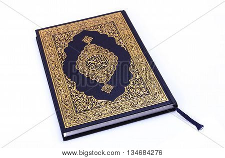 Qur'an or Koran is the central religious text of Islam which Muslims believe to be a revelation from God,isolated on white