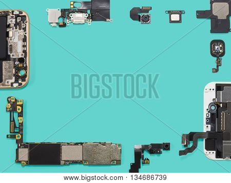 Flat lay (top view) of smart phone components isolate on blue background with copy space