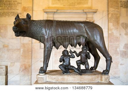 ROME, ITALY - APRIL 8, 2016:  Sculpture of a mother-wolf feeding Romulus and Remus, Rome, Italy