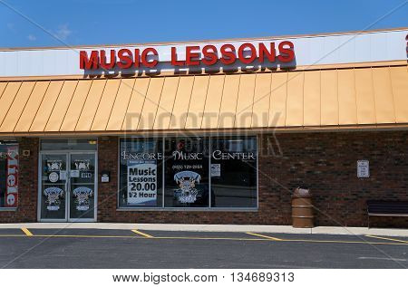 SHOREWOOD, ILLINOIS / UNITED STATES - AUGUST 21, 2015: Brandolino's Encore Music Center offers 30-minute music lessons for $20, in a Shorewood strip mall.
