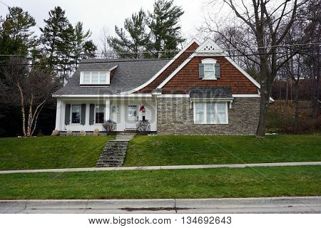 HARBOR SPRINGS, MICHIGAN / UNITED STATES - DECEMBER 24, 2015: A home, under the bluff on Fourth Street in Harbor Springs, during December.