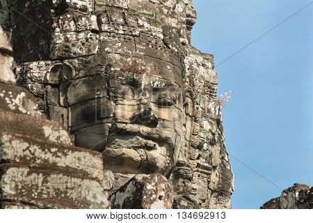Face carved into stone of the ancient Bayan Temple at Angkor Wat, Cambodia