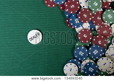 Casino gambling chips with copy space on the green cloth