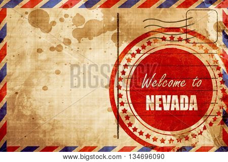 Welcome to nevada, red grunge stamp on an airmail background