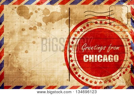 Greetings from chicago, red grunge stamp on an airmail background