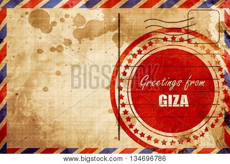 Greetings from giza, red grunge stamp on an airmail background