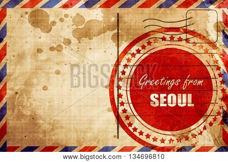 Greetings from seoul, red grunge stamp on an airmail background