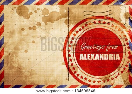 Greetings from alexandria, red grunge stamp on an airmail backgr