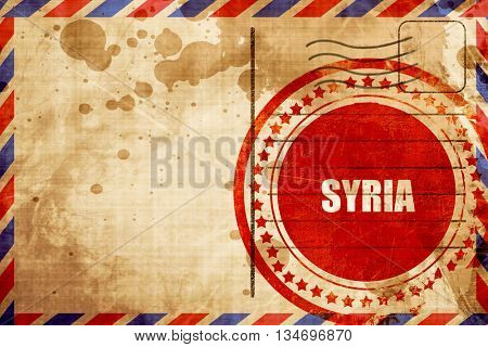 Greetings from syria, red grunge stamp on an airmail background