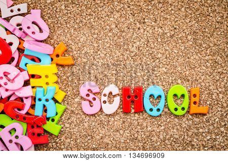 School word of colorful letters on a wooden background