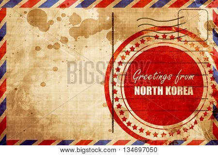Greetings from north korea, red grunge stamp on an airmail backg