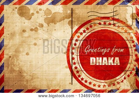 Greetings from dhaka, red grunge stamp on an airmail background