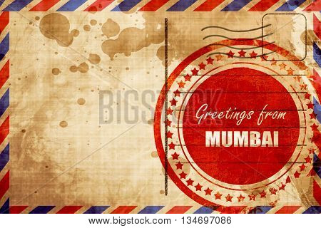 Greetings from mumbai, red grunge stamp on an airmail background